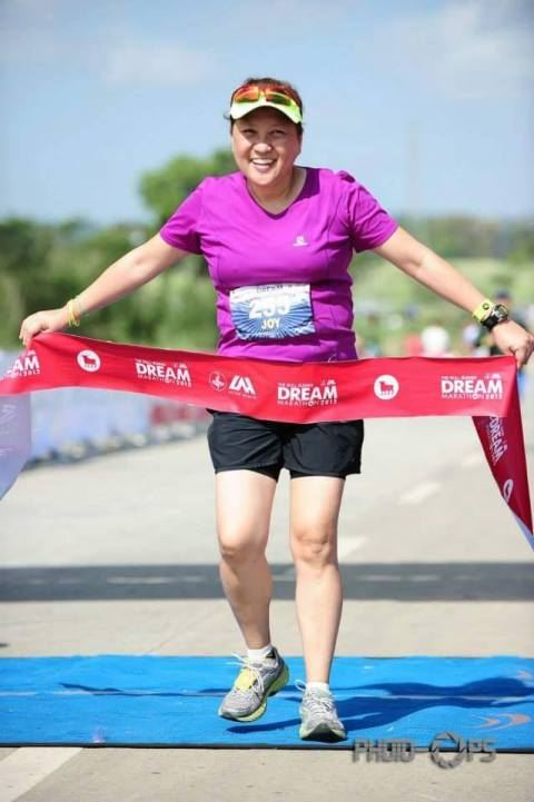 Joy crosses the finish line